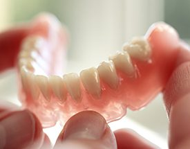 Model of smile with partial denture