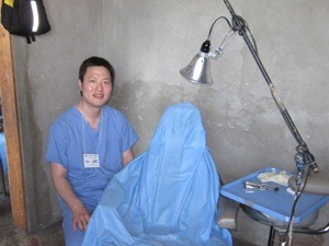 Dr. Lee beside exam chair