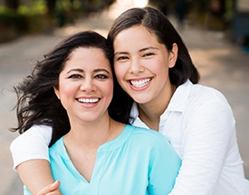 Two woman smiling outdoors