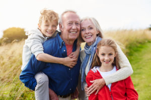 How could dental implants help my dentures in Canton?