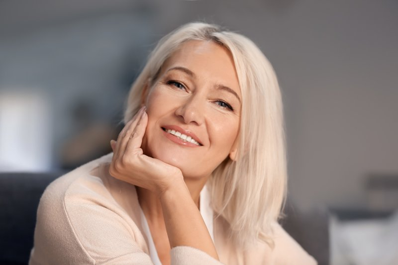 older attractive woman happy with her dental implants